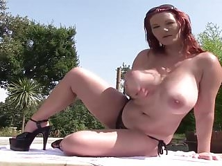 busty redhead whith big boobs strips naked in a pool 2